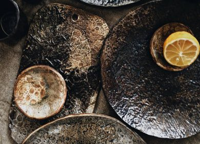 A dark ceramic pottery collection